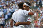 Switzerland's Roger Federer, right, greets Spain's Rafael Nadal after beating him in a Men's singles semifinal match on day eleven of the Wimbledon Tennis Championships in London, Friday, July 12, 2019. (Adrian Dennis/Pool Photo via AP)