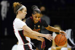 Southern California guard Desiree Caldwell, right, is defended by Stanford guard Lacie Hull during the first half of an NCAA college basketball game in Santa Cruz, Calif., Sunday, Jan. 24, 2021. (AP Photo/Jeff Chiu)