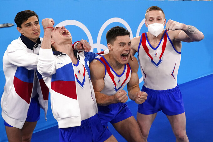 Russian Olympic Committee's artistic gymnastics men's team, from right, Denis Abliazin, Nikita Nagornyy, David Belyavskiy and Artur Dalaloyan celebrate after winning the gold medal at the 2020 Summer Olympics, Monday, July 26, 2021, in Tokyo. (AP Photo/Gregory Bull)
