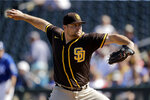 FILE - San Diego Padres pitcher David Bednar throws during the third inning of a spring training baseball game against the San Diego Padres in Surprise, Ariz., in this Monday, Feb. 24, 2020, file photo. The San Diego Padres brought right-hander Joe Musgrove to his hometown team Tuesday, adding yet another starting pitcher in a seven-player trade involving the Pittsburgh Pirates and New York Mets. The Padres, who believe they can contend for the World Series title, will send major league reliever David Bednar and three prospects —outfielder Hudson Head, left-hander Omar Cruz and right-hander Drake Fellows — to the Pirates. As part of the agreement, the Padres will send left-hander Joey Lucchesi to New York, and the Pirates will receive catcher Endy Rodríguez from the Mets. (AP Photo/Charlie Riedel)