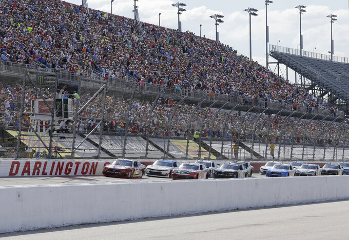 Ryan Blaney leads the field to the start the NASCAR Xfinity Series auto race on Saturday, Aug. 31, 2019, at Darlington Raceway in Darlington, S.C.. (AP Photo/Terry Renna)