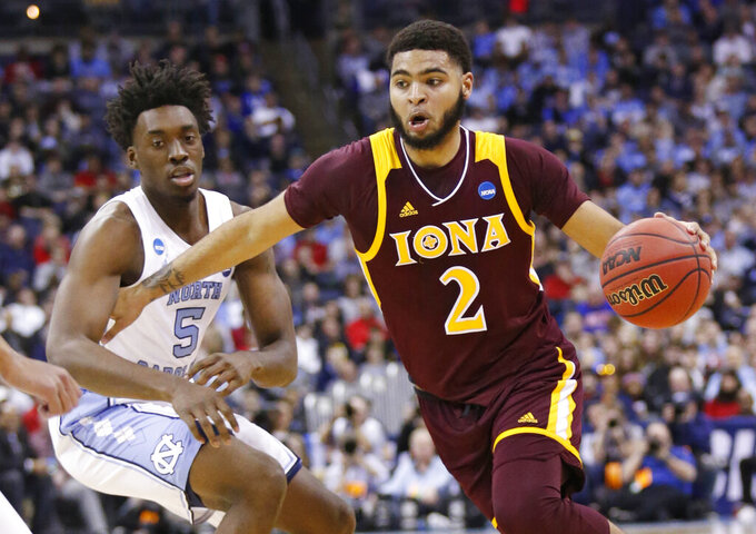 Iona's E.J. Crawford (2) drives past North Carolina's Nassir Little (5) in the first half during a first round men's college basketball game in the NCAA Tournament in Columbus, Ohio, Friday, March 22, 2019. (AP Photo/Paul Vernon)