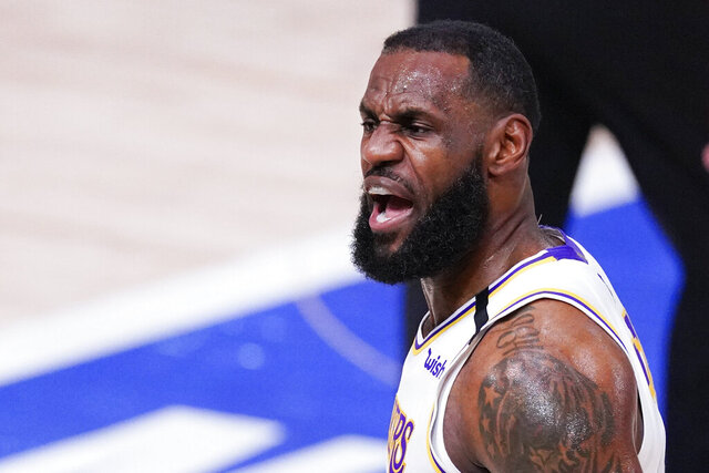 Los Angeles Lakers' LeBron James celebrates after making a 3-point shot during the first half of an NBA conference semifinal playoff basketball game against the Houston Rockets Saturday, Sept. 12, 2020, in Lake Buena Vista, Fla. (AP Photo/Mark J. Terrill)
