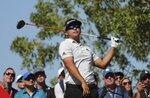 Kurt Kitamaya from the U.S. follows his ball on the 2nd hole during the final round of the Abu Dhabi Championship golf tournament in Abu Dhabi, United Arab Emirates, Sunday, Jan. 19, 2020. (AP Photo/Kamran Jebreili)