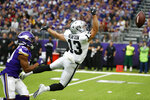Minnesota Vikings cornerback Mike Hughes, left, breaks up a pass intended for Oakland Raiders wide receiver Hunter Renfrow (13) during the second half of an NFL football game, Sunday, Sept. 22, 2019, in Minneapolis. (AP Photo/Bruce Kluckhohn)