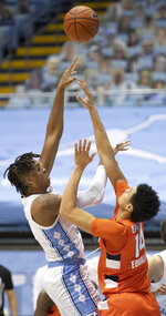North Carolina's Armando Bacot, left, shoots against Syracuse's Jesse Edwards (14) during the first half of an NCAA college basketball game Tuesday, Jan. 12, 2021, in Chapel Hill, NC. (Robert Willett/The News & Observer via AP)