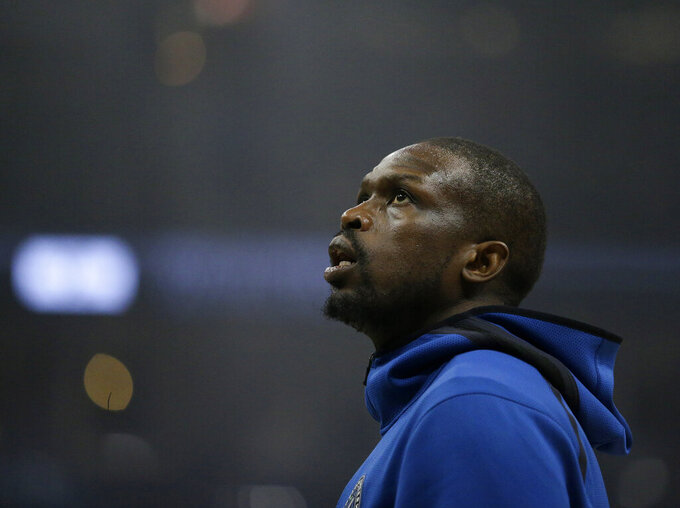 FILE - In this file photo dated Saturday, Feb. 23, 2019, Minnesota Timberwolves' Luol Deng warms up before an NBA basketball game in Milwaukee, USA. The two-time NBA All Star, who became president of the South Sudan basketball federation after retiring as a player last year, Luol Deng wants to build up basketball in his native South Sudan that may mean him coaching the national team himself, as they prepare to play against Mali upcoming Saturday Nov. 28 2020. (AP Photo/Aaron Gash, FILE)