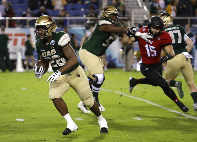 UAB running back Spencer Brown (28) runs as Northern Illinois defensive end Sutton Smith (15) is blocked during the first half of the Boca Raton Bowl NCAA college football game, Tuesday, Dec. 18, 2018, in Boca Raton, Fla. UAB won 37-13. (AP Photo/Lynne Sladky)