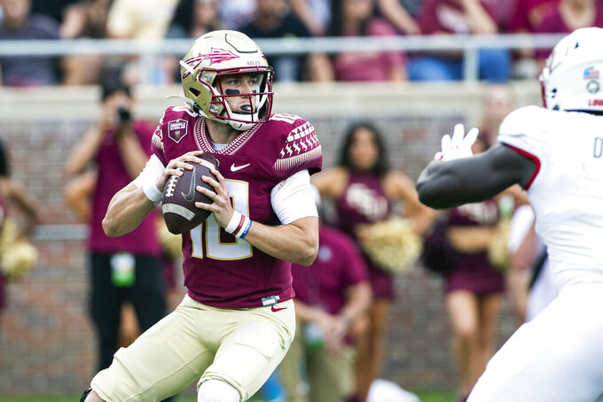 Florida State quarterback McKenzie Milton looks to pass in the first half of an NCAA college football game against Louisville in Tallahassee, Fla., Saturday, Sept. 25, 2021. (AP Photo/Mark Wallheiser)