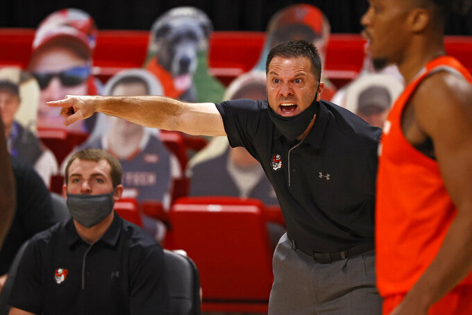 Sam Houston State coach Jason Hooten yells out to his team during the first half of an NCAA college basketball game against Texas Tech, Friday, Nov. 27, 2020, in Lubbock, Texas. (AP Photo/Brad Tollefson)