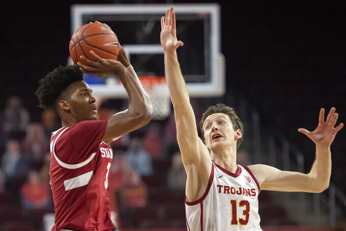 Stanford forward Ziaire Williams, left, shoots over Southern California guard Drew Peterson during the first half of an NCAA college basketball game Wednesday, March 3, 2021 in Los Angeles. (AP Photo/Kyusung Gong)
