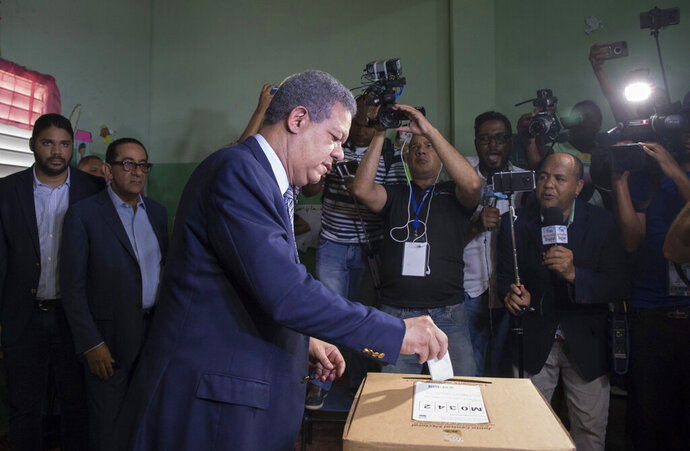 Leonel Fernandez, a former president of the Dominican Republic who is running for the presidential nomination with the political party Partido de la Liberacion Dominicana, votes during the primary election in Santo Domingo, Dominican Republic, Sunday, Oct. 6, 2019. (AP Photo/Tatiana Fernandez)