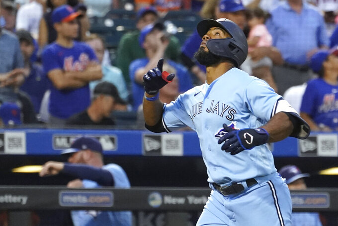 Toronto Blue Jays' Teoscar Hernandez gestures while running the bases after hitting a two-run home run during the third inning of the team's baseball game against the New York Mets, Saturday, July 24, 2021, in New York. (AP Photo/Mary Altaffer)