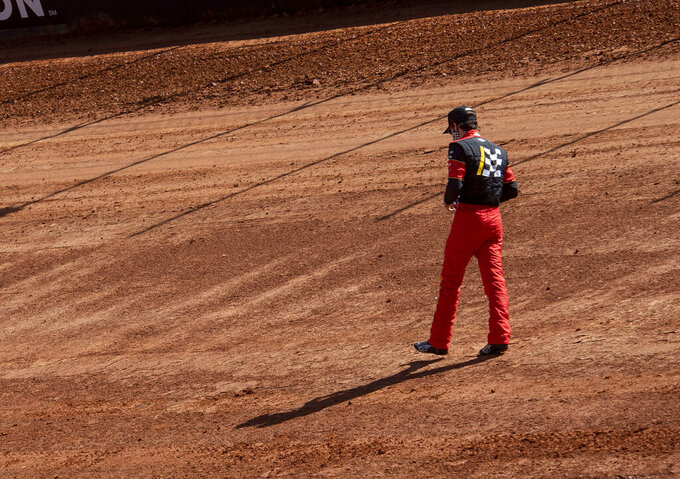 Nascar Cup Series driver Ryan Blaney walks around a section of the new dirt track, Friday, March 26, 2021, at Bristol Motor Speedway in Bristol, Tenn. (David Crigger/Bristol Herald Courier via AP)