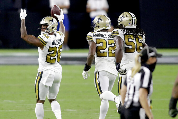 New Orleans Saints cornerback P.J. Williams (26) celebrates after recovering a fumble against the Las Vegas Raiders during the second half of an NFL football game, Monday, Sept. 21, 2020, in Las Vegas. (AP Photo/Isaac Brekken)