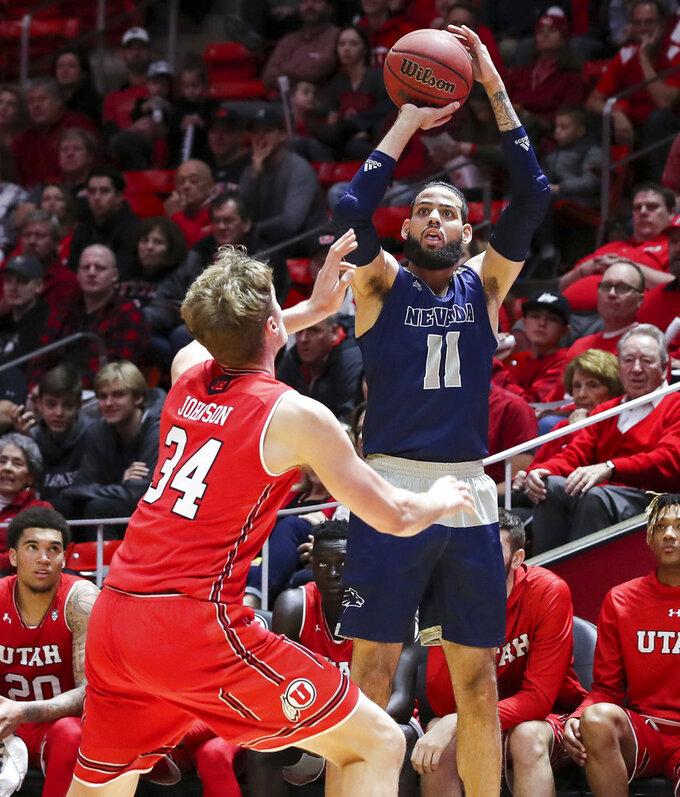 Nevada forward Cody Martin (11) shoots the ball over Utah center Jayce Johnson (34) during the first half of an NCAA college basketball game, Saturday, Dec. 29, 2018, in Salt Lake City. (AP Photo/Chris Nicoll)