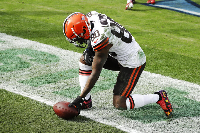 Cleveland Browns wide receiver Jarvis Landry (80) lays the ball down after catching a touchdown pass against the Tennessee Titans in the first half of an NFL football game Sunday, Dec. 6, 2020, in Nashville, Tenn. (AP Photo/Ben Margot)