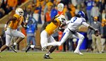 Kentucky quarterback Terry Wilson (3) tries to escape from Tennessee linebacker Darrell Taylor (19) in the second half of an NCAA college football game Saturday, Nov. 10, 2018, in Knoxville, Tenn. Tennessee won 24-7. (AP Photo/Wade Payne)
