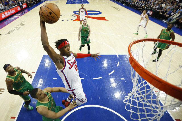 Philadelphia 76ers' Josh Richardson (0) goes up to dunk past Boston Celtics' Grant Williams (12) during the second half of an NBA basketball game, Thursday, Jan. 9, 2020, in Philadelphia. (AP Photo/Matt Slocum)