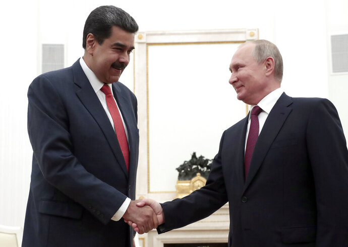 Russian President Vladimir Putin, right, shakes hands with Venezuela's President Nicolas Maduro during their meeting in the Kremlin in Moscow, Russia, Sept. 25, 2019. Nicolas Maduro is on a working visit to Moscow. (Sergei Chirikov/Pool Photo via AP)