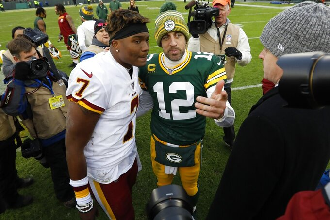 Green Bay Packers' Aaron Rodgers talks to Washington Redskins' Dwayne Haskins after an NFL football game Sunday, Dec. 8, 2019, in Green Bay, Wis. The Packers won 20-15. (AP Photo/Mike Roemer)