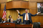 Rep. Doug Collins, R-Ga., the ranking member on the House Judiciary Committee, right, throws his arms up in the air in frustration after a one minute recess is called shortly before the hearing comes to a close in the questioning of Corey Lewandowski, former campaign manager for President Donald Trump, Tuesday, Sept. 17, 2019, on Capitol Hill in Washington. At far left is Majority Staff Counsel Barry Berke, with House Judiciary Committee chairman Rep. Jerrold Nadler of N.Y., at center. (AP Photo/Jacquelyn Martin)