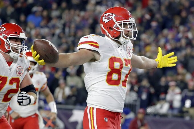 Kansas City Chiefs tight end Travis Kelce, left, celebrates his touchdown in the first half of an NFL football game against the New England Patriots, Sunday, Dec. 8, 2019, in Foxborough, Mass. (AP Photo/Steven Senne)