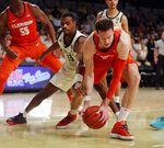 Clemson forward David Skara (24) and Georgia Tech guard Curtis Haywood II (13) battle for the ball during the first half of an NCAA college basketball Wednesday, Feb. 6, 2019, in Atlanta. (AP Photo/John Bazemore)