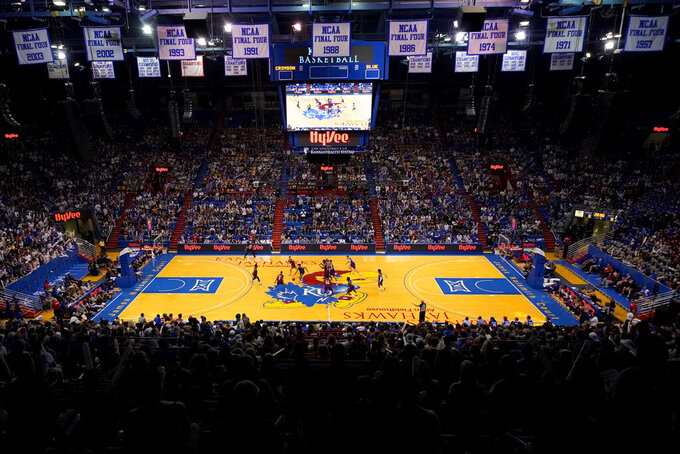 Kansas players scrimmage during Late Night in the Phog, the school's annual NCAA college basketball kickoff, at Allen Fieldhouse in Lawrence, Kan. Friday, Oct. 1, 2021. (AP Photo/Charlie Riedel)