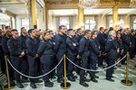 Paris Firefighters' brigade and security forces who took part to the fire extinguishing operations of the Notre Dame of Paris Cathedral listen to French President Emmanuel Macron at the Elysee Palace in Paris, Thursday, April 18, 2019. France paid a daylong tribute Thursday to the Paris firefighters who saved the internationally revered Notre Dame Cathedral from collapse and rescued many of its treasures.(Christophe Petit Tesson, Pool via AP)