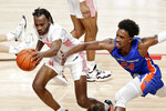 Houston guard DeJon Jarreau (3) gets a loose ball in front of Boise State forward Abu Kigab (24) during the first half of an NCAA college basketball game Friday, Nov. 27, 2020, in Houston. (AP Photo/Michael Wyke)
