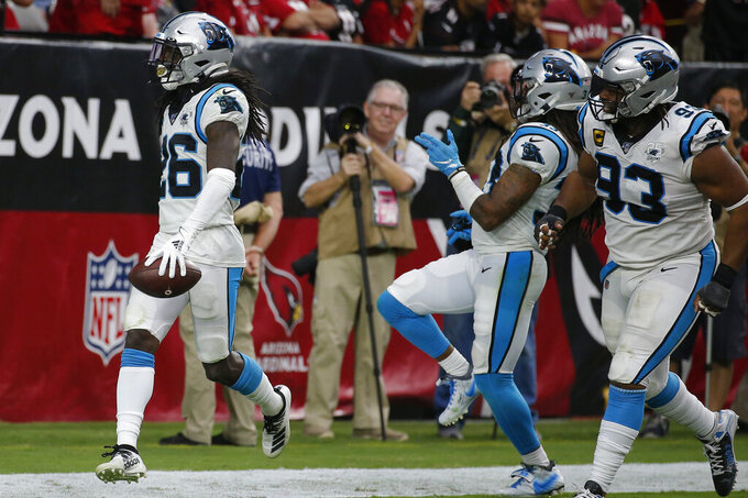 Carolina Panthers cornerback Donte Jackson (26) celebrates his interception against the Arizona Cardinals during the second half of an NFL football game, Sunday, Sept. 22, 2019, in Glendale, Ariz. (AP Photo/Rick Scuteri)