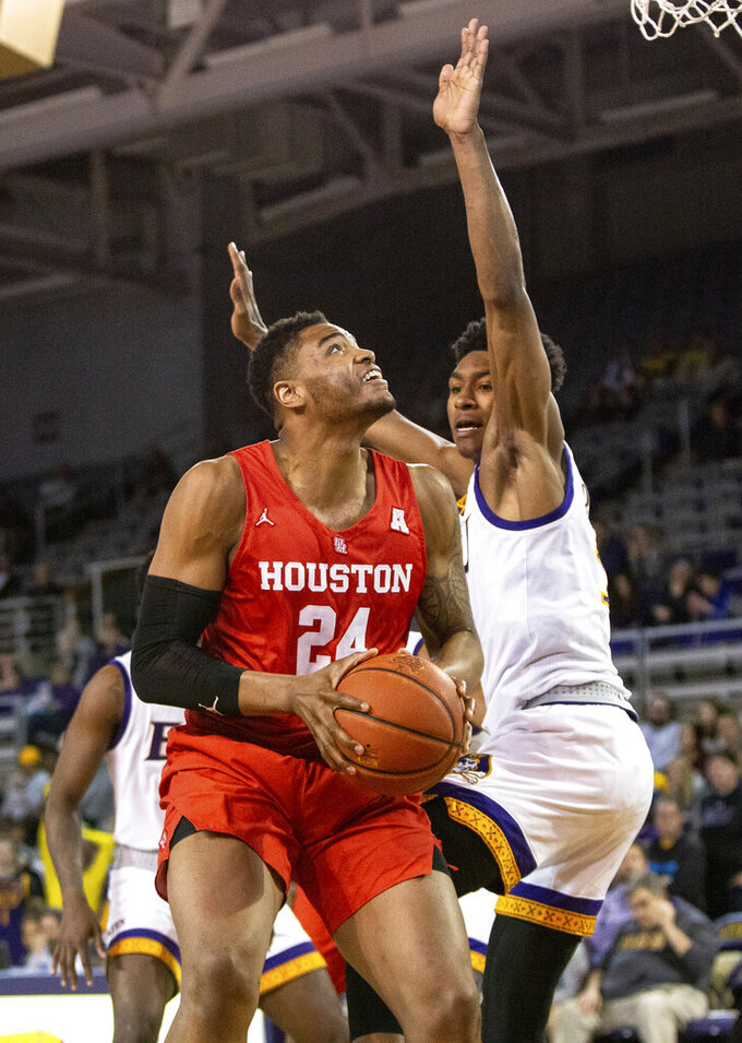 Houston's Breaon Brady (24) works in the post against Houston's Armoni Brooks, right, during the second half of an NCAA college basketball game in Greenville, N.C., Wednesday, Feb. 27, 2019. (AP Photo/Ben McKeown)