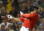 Boston Red Sox's Rafael Devers watches his RBI double during the sixth inning against the Los Angeles Dodgers in a baseball game at Fenway Park, Friday, July 12, 2019, in Boston. (AP Photo/Elise Amendola)