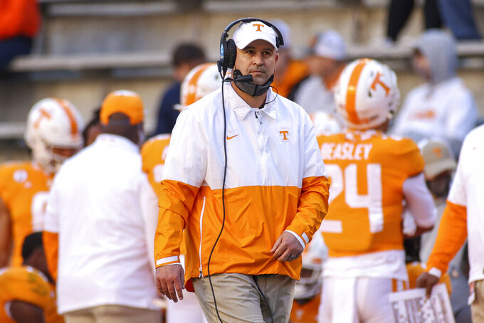 Tennessee coach Jeremy Pruitt watches during the first half of the team's NCAA college football game against Florida on Saturday, Dec. 5, 2020, in Knoxville, Tenn. (Randy Sartin/Knoxville News Sentinel via AP, Pool)