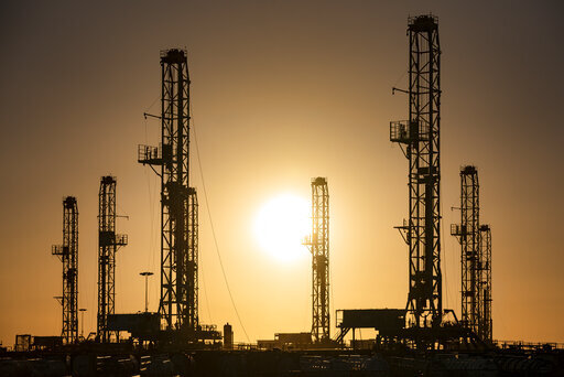 The morning sun rises behind oil rigs sitting in storage Saturday, Feb. 6, 2021 at a yard outside of Odessa, Texas. The OPEC oil cartel and allied countries said Thursday, April 1, 2021 that they have decided to add gradually add back some 2 million barrels per barrel per day of oil production from May to July, moving cautiously in pace with the recovery of the global economy from the COVID-19 pandemic. (Eli Hartman/Odessa American via AP, file)