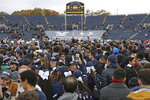 FILE - In this Nov. 18, 2017, file photo, Yale students rush the field after Yale defeated Harvard in an NCAA college football game in New Haven, Conn. As they return, players will face new protocols to combat the spread of the delta variant.  (AP Photo/Gregory Payan, File)