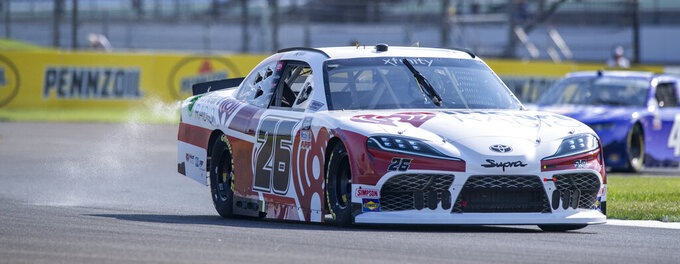 Kris Wright (26) during practice for the NASCAR Xfinity Series auto race at Indianapolis Motor Speedway, Friday, Aug. 13, 2021, in Indianapolis. (AP Photo/Doug McSchooler)
