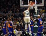 Milwaukee Bucks' Giannis Antetounmpo  (34) dunks against the New York Knicks during the first half of an NBA basketball game Monday, Dec. 2, 2019, in Milwaukee. (AP Photo/Jeffrey Phelps)