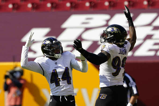 Baltimore Ravens' Marlon Humphrey (44) and Matt Judon (99) celebrate a fumble recovery against the Washington Football Team during the first half of an NFL football game, Sunday, Oct. 4, 2020, in Landover, Md. (AP Photo/Susan Walsh)