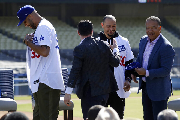 New Los Angeles Dodgers players David Price and Mookie Betts are greeted by Dodger President, Baseball Operations, Andrew Friedman and manager Dave Roberts during a news conference to announce their acquisition at the Dodger Stadium in Los Angeles, Wednesday, Feb. 12, 2020. (AP Photo/Chris Carlson)