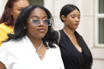 Azriel Clary, left, and Joycelyn Savage, right, two women who lived in Chicago with R&B singer R. Kelly, leave Brooklyn federal court following his arraignment, Friday, Aug. 2, 2019 in New York. Kelly pleaded not guilty Friday to federal charges he sexually abused women and girls. The 52-year-old Kelly was denied bail in a Brooklyn courtroom packed with his supporters. . (AP Photo/Mark Lennihan)
