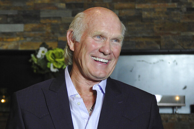 FILE - In this April 4, 2012, file photo, Hall of Fame quarterback Terry Bradshaw smiles in Nashville, Tenn. From a sackmaster defensive tackle to a do-everything running back, the list of the NFL's greatest characters, numbers 31-100, is impressive. (AP Photo/Joe Howell, File)