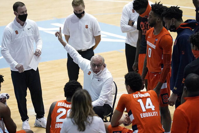 Syracuse coach Jim Boeheim speaks with his team during the first half of an NCAA college basketball game against North Carolina in Chapel Hill, N.C., Tuesday, Jan. 12, 2021. (AP Photo/Gerry Broome)