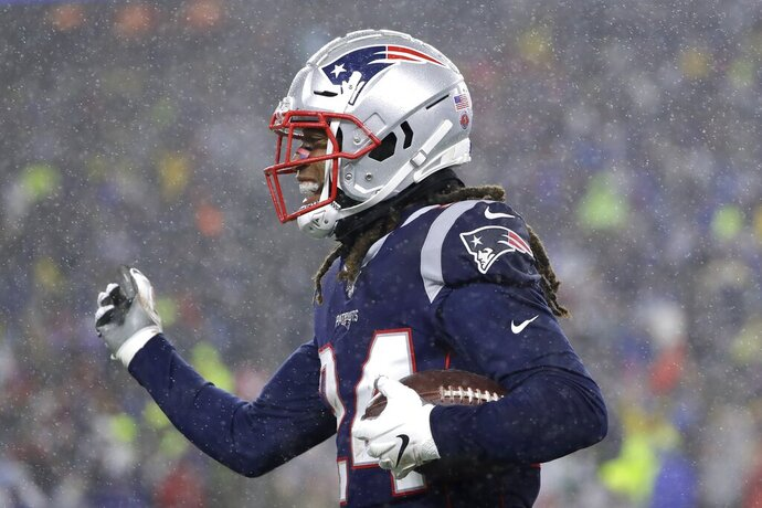 New England Patriots cornerback Stephon Gilmore celebrates his interception against the Dallas Cowboys in the first half of an NFL football game, Sunday, Nov. 24, 2019, in Foxborough, Mass. (AP Photo/Steven Senne)