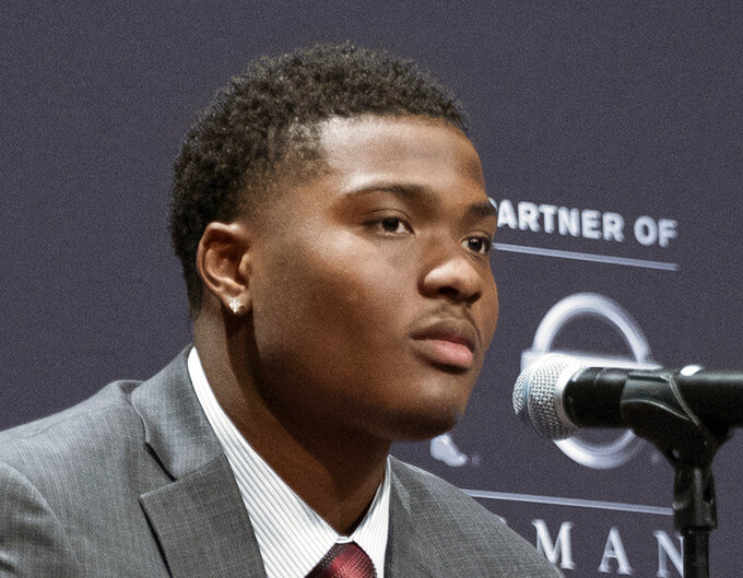FILE - In this Dec. 8, 2018, file photo, Heisman Trophy finalist Dwayne Haskins, from Ohio State looks on during a press conference in New York. Record-setting Ohio State quarterback Dwayne Haskins Jr. says he is leaving school to enter the NFL draft. The third-year sophomore announced Monday, Jan. 7, 2019, on Twitter that he will depart the program after one year as a starter in which he broke most school and Big Ten single-season passing records. He also finished third in Heisman Trophy voting. (AP Photo/Craig Ruttle, File)