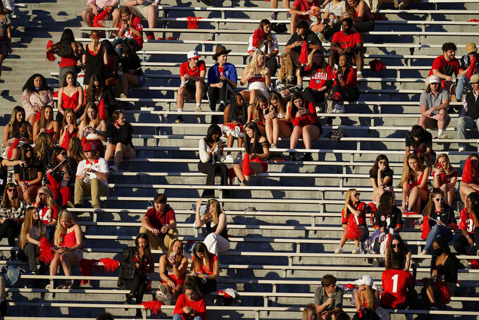 Georgia students gather in the stands before an NCAA college football game between Georgia and Auburn, Saturday, Oct. 3, 2020, in Athens, Ga. (AP Photo/Brynn Anderson)