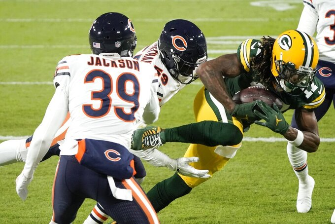 Green Bay Packers' Davante Adams catches a touchdown pass during the first half of an NFL football game against the Chicago Bears Sunday, Nov. 29, 2020, in Green Bay, Wis. (AP Photo/Morry Gash)