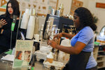 In this Friday, Jan. 4, 2018 photo, Colada employee Daphne Bissainte spikes an espresso at Colada in Fort Lauderdale, Fla. South Florida restaurants are buzzing over CBD in recent months, touting the oil's ability to treat everything from chronic pain to anxiety. Here's the problem: Some CBD-laced foods contain trace amounts of THC (tetrahydrocannabinol), the psychoactive substance in marijuana that produces a euphoric high. THC is illegal in Florida for those without a medical marijuana card. (Jennifer Lett/South Florida Sun-Sentinel via AP)