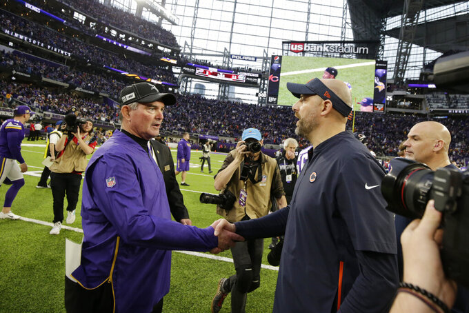 Minnesota Vikings head coach Mike Zimmer, left, greets Chicago Bears head coach Matt Nagy after an NFL football game, Sunday, Dec. 29, 2019, in Minneapolis. The Bears won 21-19. (AP Photo/Andy Clayton-King)